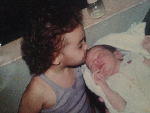 My lovely sister Ruthy kissing me (the red baldish baby). She has always been a lovely representation of kindness in my life.